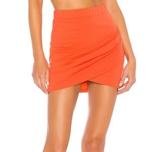 Mini skirt with side slit and ruching
